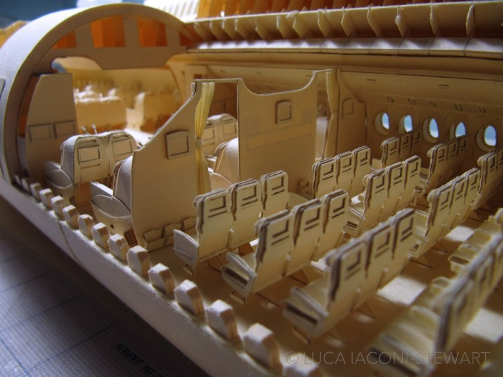Kid Built An Incredibly Detailed Model Of A Boeing 777 From Cut-Up Paper Folders