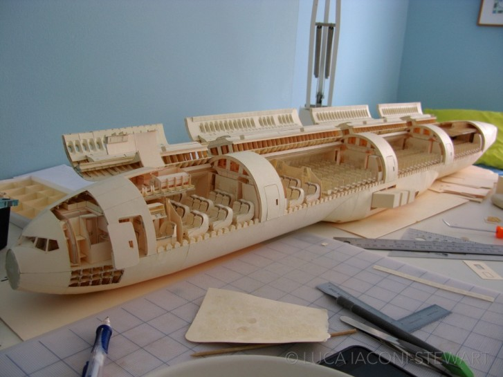 completed-cabin Kid Built An Incredibly Detailed Model Of A Boeing 777 From Cut-Up Paper Folders