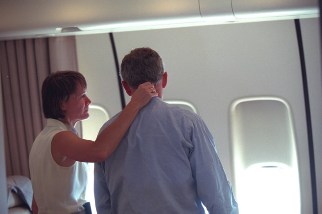 The president is consoled by presidential nurse Cindy Wright, of the White House Medical Unit, aboard Air Force One. | Eric Draper/George W. Bush Presidential Library and Museum